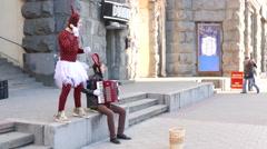 Street clowns earn money  in city 4k ( 3840x2160) - stock footage