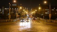 night city - urban street with cars and people walking - lights - timelapse - stock footage