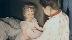 USA 1956: little girl having a doll as a Christmas present Stock Footage