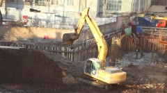 Excavator excavate work on construction workers, owned great building company Stock Footage
