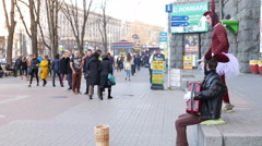 Street clowns earn money  in city 4k ( 3840x2160) Stock Footage