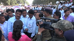 India, teachers protest, television interview, camera crew, police officers Stock Footage