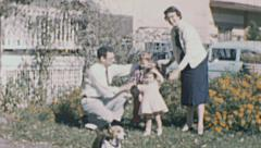 USA 1957: family portrait in the backyard - stock footage