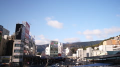 Time Lapse of Blue Sky over Atami Station in Japan -Pan Right- Stock Footage