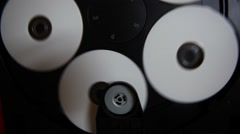 Inside machinery cd player,rotating disc,white cd Stock Footage