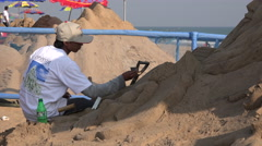 India, artists create sand sculptures during festival, disability theme - stock footage