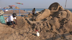 India, artists create sand sculptures during international festival Stock Footage