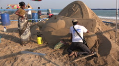 Artists create sand art projects, disability theme, beach, sculptures, India - stock footage