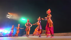 Women perform traditional dance, wearing costumes, on stage in Konark, India - stock footage