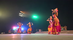 Women perform a classic Indian dance on stage during festival - stock footage