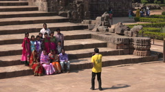 Family portrait on the steps of the Konark Sun Temple in India Stock Footage