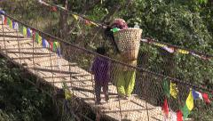 Nepal village, rural scene, mother, child, wooden footbridge, plastic bottles Stock Footage