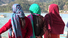 Nepal tourism, three local women look out over Phewa lake in Pokhara Stock Footage