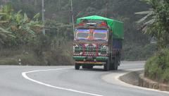 Colorful cargo truck drives over Kathmandu to Pokhara highway, Nepal - stock footage