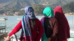 Tourism Nepal, local women, Phewa lake, Pokhara, colorful dresses Stock Footage