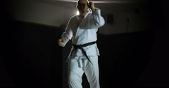 A male martial arts instructor shadow practicing in slow motion. Stock Footage