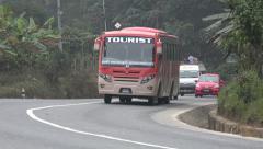 Traffic drives over the Kathmandu to Pokhara highway, Nepal Stock Footage