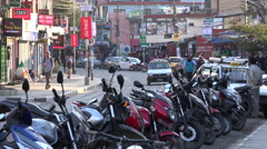 Main tourist street in Pokhara, Nepal, motorbike parking lot Stock Footage