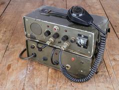 old amateur ham radio on wooden table - stock photo