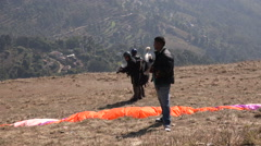 Adventure sports in Nepal Asia, people use a hawk to paraglide Stock Footage