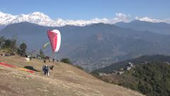 Nepal, paragliding, paragliders take of before Himalayan mountain scenery Stock Footage