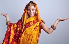 Little girl in traditional Indian clothing and jeweleries Stock Photos