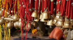 Bells for sale at market during Pushkar Camel Fair, India Stock Footage