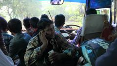 Bangladesh, a young man uses a smartphone is a busy bus Stock Footage
