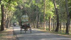 Stock Video Footage of Bangladesh, a cycle rickshaw is overtaken by a motorized 'competitor'