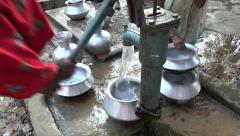 Bangladesh, women using a water pump in village Stock Footage