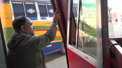 Bangladesh, Dhaka, bus conductor tries to attract passengers Stock Footage