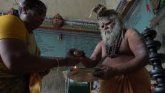 India, a guru gives blessings and hands out money during ceremony Stock Footage