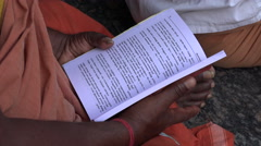 A man reads verses during a joyful religious ceremony in South India - stock footage