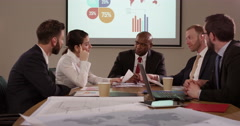 Team of multi ethnic business people in a meeting. Slow motion. Stock Footage