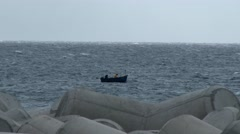 MADEIRA, PORTUGAL NOVEMBER 2014: A small fishing boat in a stormy Atlantic ocean - stock footage