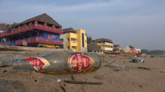 Empty beer bottle, alcohol problem, beach, India Stock Footage