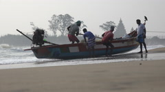 Fishermen at work on a beach in South India Stock Footage
