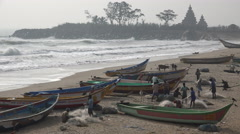 India, fishing community, temple complex, beach, sea, waves Stock Footage