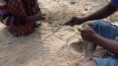 South India, Tamil Nadu, fishermen untwist nets at beach Stock Footage