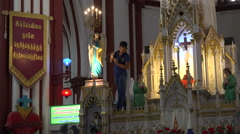 India, a worker cleans the altar of a cathedral in Pondicherry Stock Footage