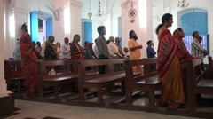 People attend mass inside an Indian cathedral Stock Footage