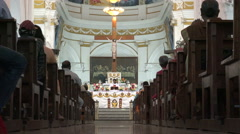 Cathedral in India, priest gives a speech, view down aisle Stock Footage