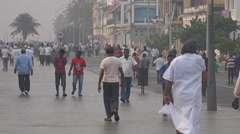 India, people walk over Pondicherry's boulevard for a morning stroll Stock Footage