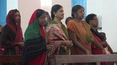 Church mass India cathedral women saris singing Christian - stock footage