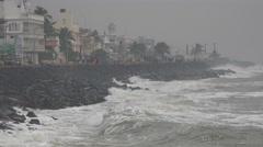 India, Pondicherry, crashing waves, shore, storm, rainy weather Stock Footage