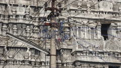Temple complex behind electricity wires, India Stock Footage
