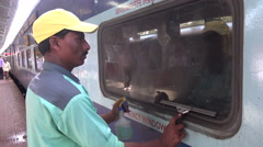 India, cleaning the window of a long distance train Stock Footage