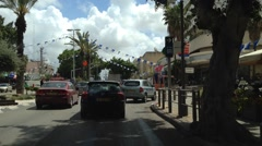 Driving in Raanana street 3 weeks before Independence Day - stock footage