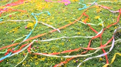 Wind with Colored papers placed on a grave during Qingming Festival Stock Footage