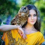 Beautiful young girl with owl - stock photo